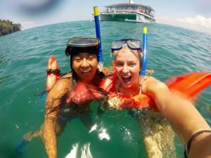 My friend Lauren and I snorkeling on the catamaran